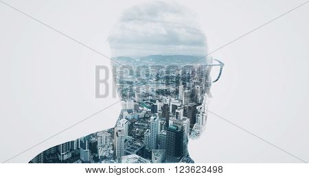 Photo of stylish bearded banker wearing trendy suit and looking city. Double exposure, panoramic view contemporary megalopolis background. Space for your business message.  Isolated white.
