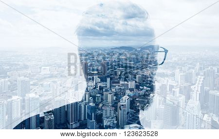 Photo of stylish bearded banker wearing trendy suit and looking city. Double exposure, panoramic view contemporary megalopolis background. Space for your business message.