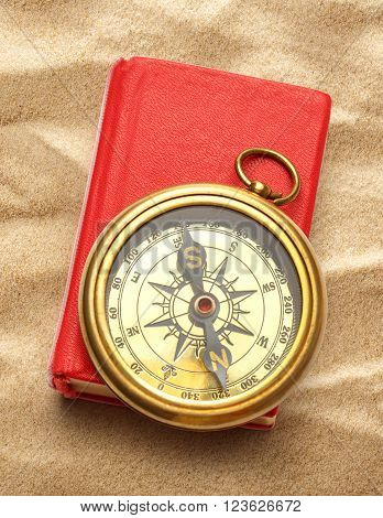Red Closed Book With Retro Compass