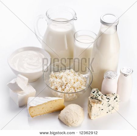 Different milk products: cheese, cream, milk, youghurt. On a white background.