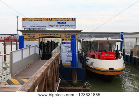 Venice, Italy - March 17, 2016: Vaporetto (water bus) at Venice airport. Vaporettos are a traditional, flat-bottomed Venetian motor boat, well suited to the conditions of the Venetian lagoon