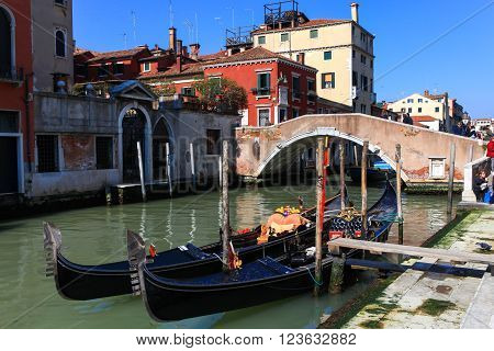 Venice, Italy - March 19, 2016: Gondolier and Gondola at Venice grand canal. The Gondola is a traditional, flat-bottomed Venetian rowing boat, well suited to the conditions of the Venetian lagoon