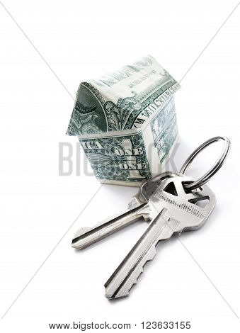 House keys and dollar origami house isolated on white