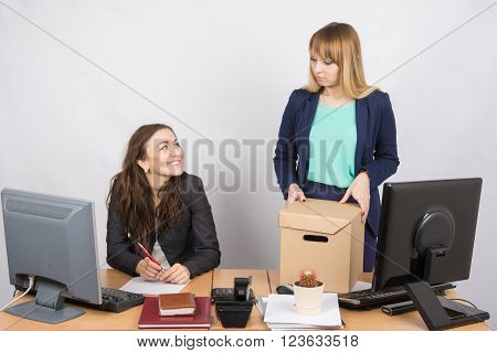 Office gesture girl humiliates the dismissed colleague