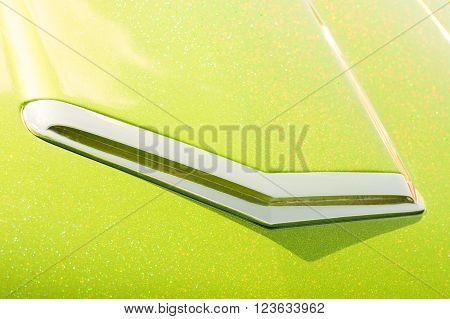 lime green glitter covered retro vehicle hood