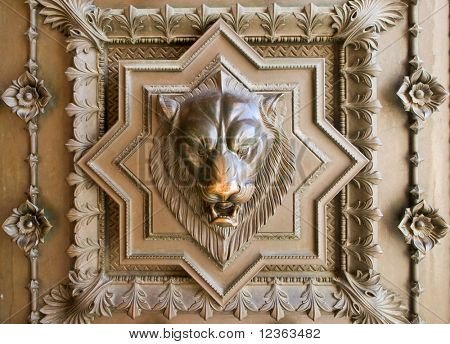 Bronze bas-relief of a lion head from the gate of basilica in Lyon, France