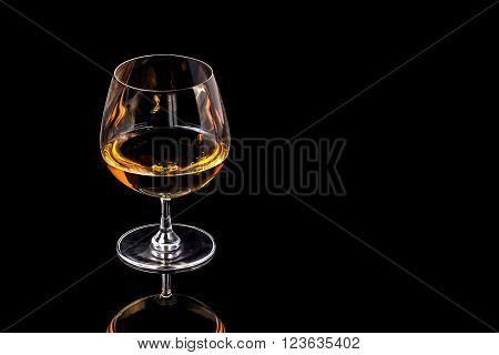 Goblet of Brandy on the black background