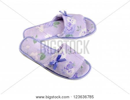 Pair of purple slippers. Isolate on white.
