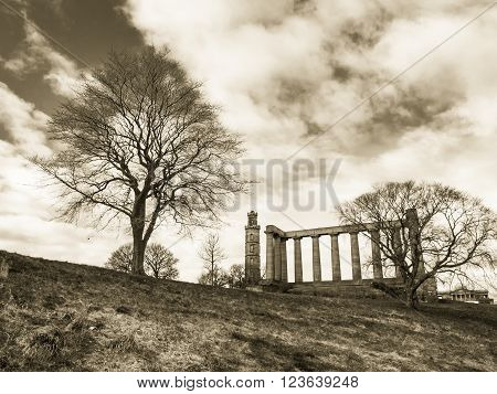 EDINBURGH, SCOTLAND - MARCH 6: Nelson Monument and National Monument on Calton Hill in Edinburgh at March 6, 2016
