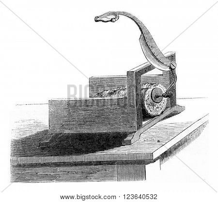 Bread cutting machine, vintage engraved illustration. Magasin Pittoresque 1857.