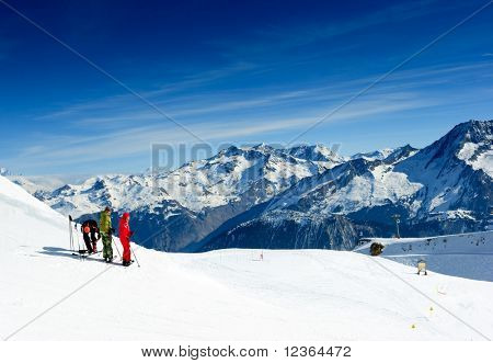 Skiers on the top of the mountain in Meribel Valley at French Alps