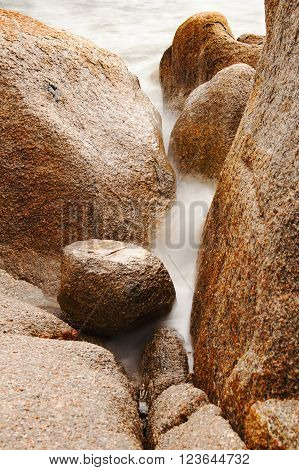 Umber stones in the sea, coast of Corsica