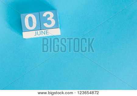 June 3rd. Image of june 3 wooden color calendar on blue background.  Summer day, empty space for text.