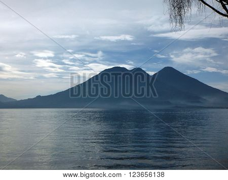 Three volcanoes (including Atitlan and Toliman) on a clear morning at the crater lake Lake Atitlan in Guatemala.