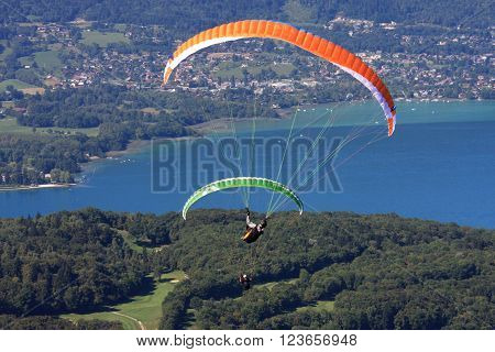 paragliders flyong above Lake Annecy in France