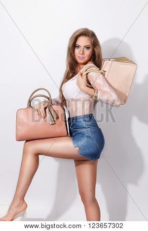 Beautiful pretty woman posing with fashion bags