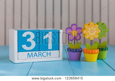 March 31st. Image of march 31 wooden color calendar on white background with flowers.  Spring day, empty space for text. World Backup Day and the month end.