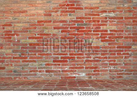 Red brick wall background in a photographer photo studio. Empty copy space for editor's text.