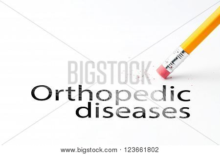 Closeup of pencil eraser and black orthopedic diseases text. Orthopedic diseases. Pencil with eraser.