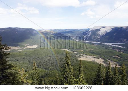 Picture of a rainbow during a hike on Nihahi Ridge in Kananasis Country,Alberta,Canada.