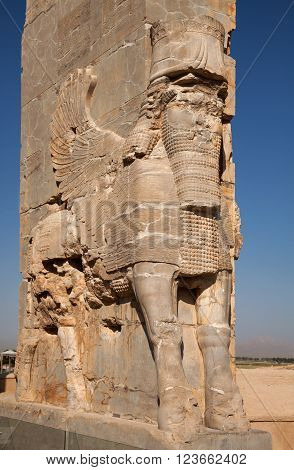 Lamassu an Assyrian protective deity often depicted as having a human's head a body of an ox or a lion and bird's wings; guarding the ancient Gate of All Nations in Persepolis of Shiraz.