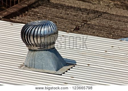 Pipe of ventilation are located on a roof of a residential building
