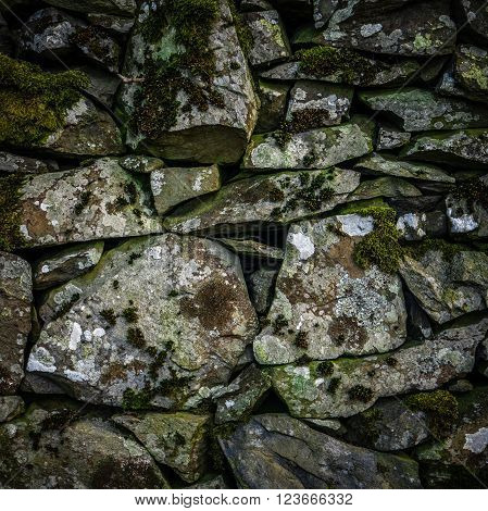 Background Texture Detail Of An Old Dry Stone Wall In Scotland