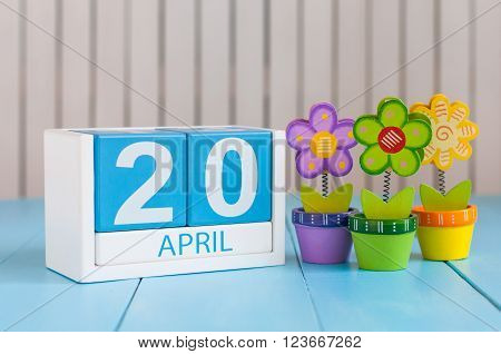 April 20th. Cannabis Day. Image of april 20 wooden color calendar on white background with flower. Spring day, empty space for text.  Secretary's DAY.