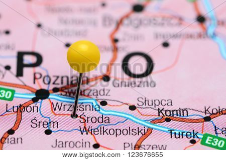Photo of pinned Sroda Wielkopolski on a map of Poland. May be used as illustration for traveling theme.