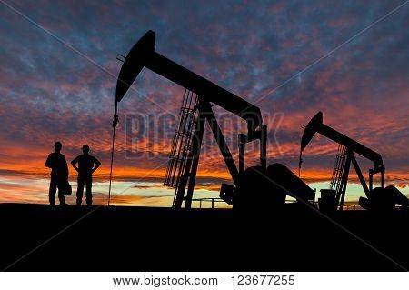Silhouettes Of Pumpjacks And Oil Workers