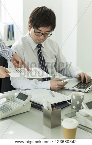 Businessmen confirming a document