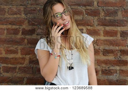 Young beautiful woman talking on her phone outdoors