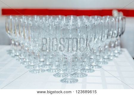 Many empty champagne and wine glasses on the table