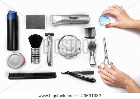 Female hands, black photo, shaving set with equipment, tools and foam, isolated on white