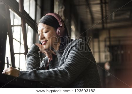Asian Woman Listening Music Headphone Writing Notebook Concept