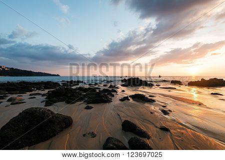 Picturesque seaview sunset in Andaman sea Naithon beach Phuket. Dramatic sunset at Naithon Beach Phuket Thailand