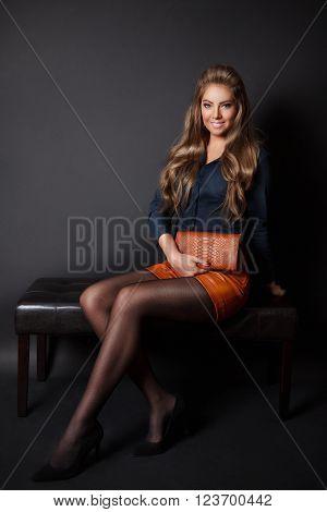 Beautiful pretty woman holding an elegant envelop bag