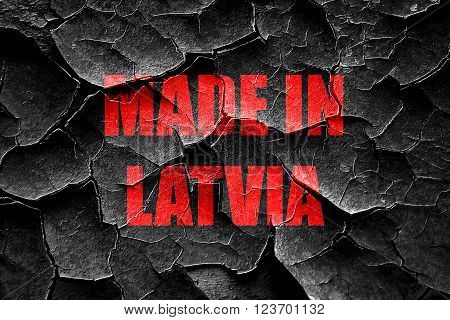 Grunge cracked Made in latvia with some soft smooth lines