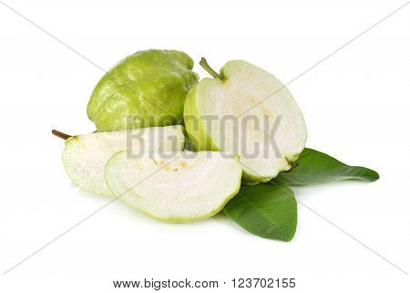 whole and half cut fresh Guava with leaves on white background