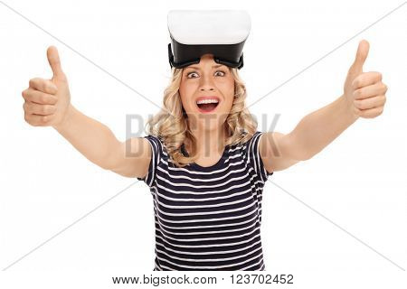 Satisfied young woman giving two thumbs up after using a VR headset isolated on white background