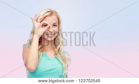 fun, emotions, expressions and people concept - smiling young woman or teenage girl making ok hand gesture over pink background