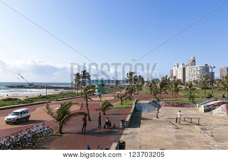 DURBAN SOUTH AFRICA - MARCH 23 2016: Many unknown people enjoy and early morning visit to beachfront in Durban South Africa