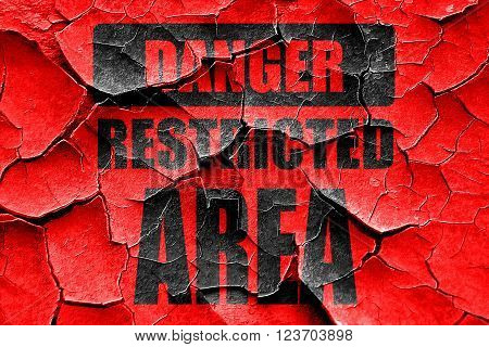 Grunge cracked Restricted area sign with some smooth lines