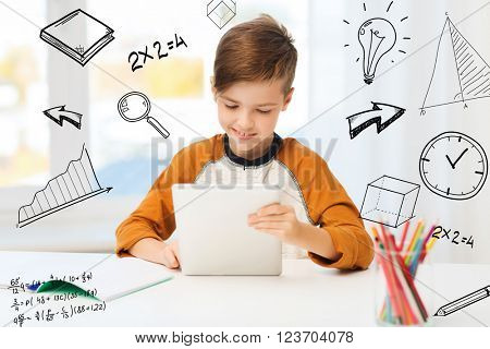 leisure, children, education, technology and people concept - smiling boy with tablet pc computer and notebook at home over mathematical doodles