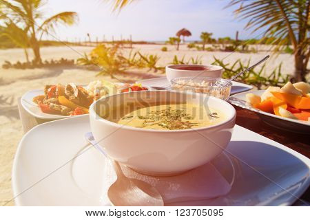 soup,  chicken rice and fruit salad served on beach restaurant