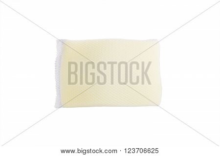 Soft yellow sponge covered by white pattern net for dish washing isolated on white background
