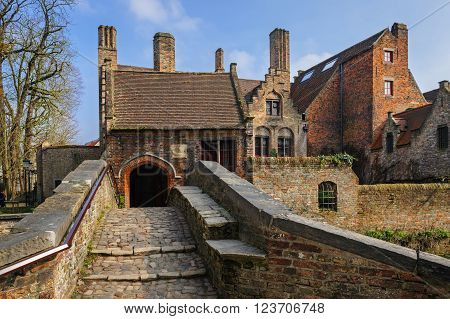 BRUGES/BELGIUM - MARCH 11, 2016: Medieval style houses along the canals of old Bruges (Brugge)