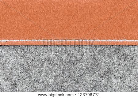 Background of close up on gray fabric texture and brown leather;