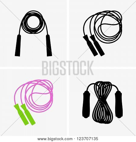 Set of four skipping ropes on grey background