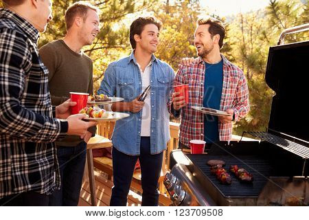 Group Of Gay Male Friends Enjoying Barbeque Together